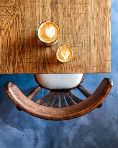 02.-Coffee-Latte-Art-on-wood-table-chair-and-floor-Izu-Brasserie